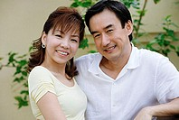 Mature couple, smiling at camera
