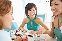 Young women in cafe, talking