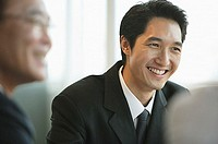 Businessman smiling, selective focus