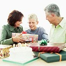 Portrait of a boy receiving presents from his grandparents