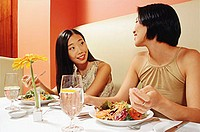 Two young women talking in restaurant