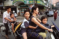 Vietnam, Ho Chi Minh City, Motorcycles and bicycles are used as an efficient means of transportation throughout Vietnam.