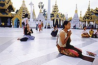 Myanmar (Burma), Yangon (Rangoon), People praying at the Shwedagon Pagoda.