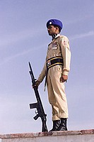 Pakistan, Sind, Karachi, Quaide-E-Azam, Army guard holding gun on duty.