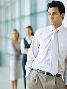 businessman standing with his hands in his pockets