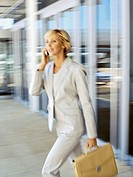 side profile of a businesswoman talking on a mobile phone