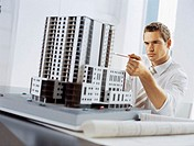 businessman looking at an architectural model