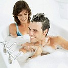 close-up of a young couple sitting in a bathtub