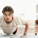 close-up of a young man doing push-ups on the floor