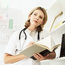 low angle view of a female doctor holding a book in her hands