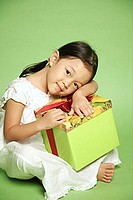 Young girl hugging gift wrapped box