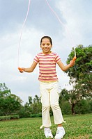 Young girl playing with a jump rope