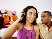 Close-up of a young couple listening to music