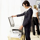 Businesswoman at a photocopy machine