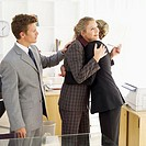 Two businesswomen hugging each other in the office