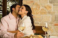 Man kissing a woman in a restaurant (thumbnail)