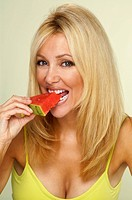 Woman eating watermellon