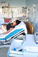 MATERNITY HOSPITAL<BR>Photo essay from hospital.<BR>Woman about to giving birth, with a fetal monitoring.