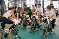 Lido Deck, Gymnasium, exercycle class, workout. Holland America Line, MS Noordam. New York. USA.