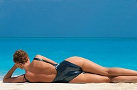 WOMAN TANNING IN SUMMER<BR>Model.