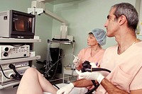 COLON, ENDOSCOPY EXAMINATION<BR>Photo essay from hospital.<BR>Doctor, assistant and patient during a colonoscopy.