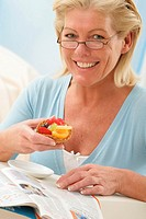 ELDERLY PERSON SNACKING<BR>Model.