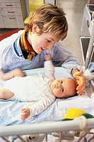 INFANT HOSPITAL PATIENT<BR>Institut de Puériculture, a prenatal and pediatric center in Paris, France. Mother nursing baby.