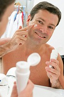 FACE CARE, MAN<BR>Model.<BR>Moisturizing cream or anti-wrinkle product.