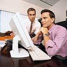 view of two businessmen sitting in front of a computer
