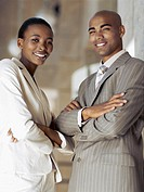 side profile of a businessman and a businesswoman standing together