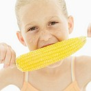 Close-up of a girl eating corn on the cob