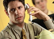 Close-up of a young businessman talking on telephone