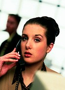 Close-up of a young businesswoman talking on telephone