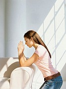 side profile of a teenage girl praying