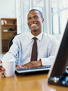 businessman looking up and smiling