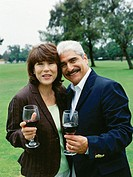 portrait of a mature couple holding glasses of wine