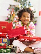 close-up of a girl sitting with christmas gifts