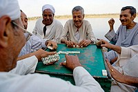 Playing dominoes. Country life in small villages along the Nile, between Qena and  Luxor. Upper Egypt