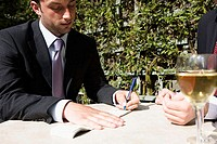 Close-up of a businessman signing a check