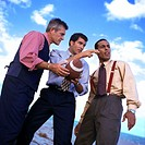 low angle view of a three businessmen with a football discussing a game plan