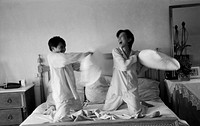 black and white side profile of a couple pillow fighting
