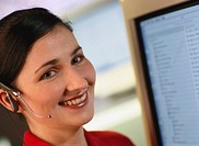 Portrait of a young businesswoman smiling wearing a headset