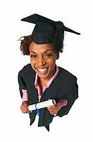 elevated portrait of a woman wearing a cap and gown holding a degree