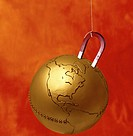 close-up of a hanging magnet holding up a metal globe