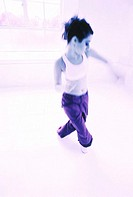 toned shot of a young woman dancing