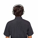 Rear view of young man wearing headphones