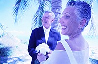tungsten view of a mature couple exchanging vows on the beach