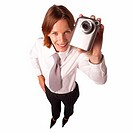 Elevated view of a businesswoman holding a camera