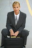 portrait of a businesswoman holding a briefcase