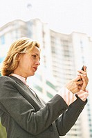 low angle view of a businesswoman looking at a mobile phone